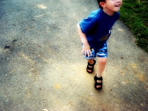 Toddler boy running about