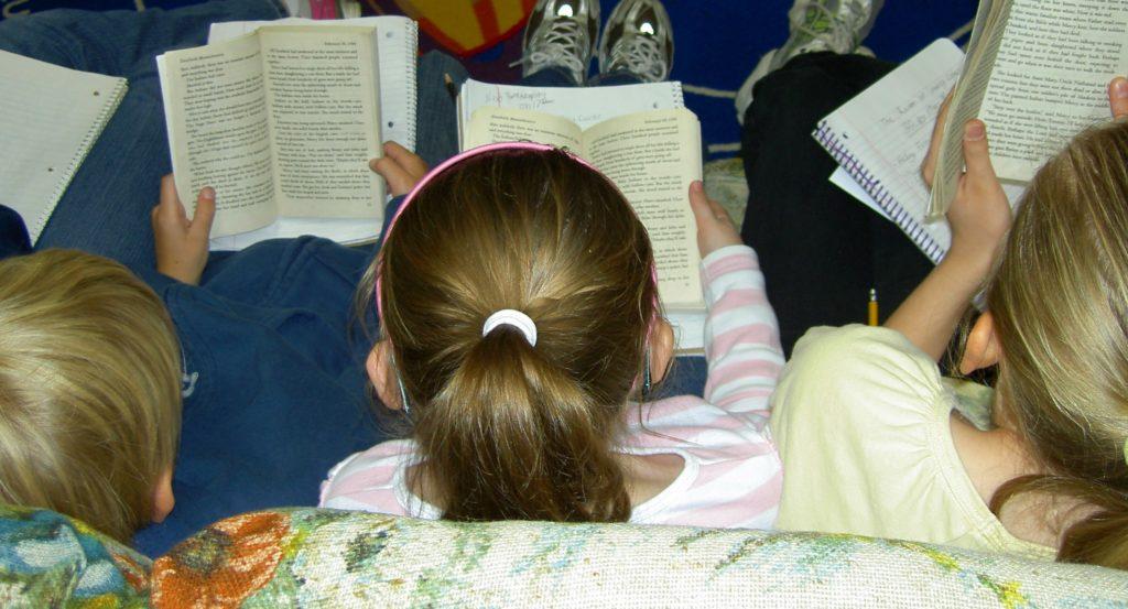 Three children reading
