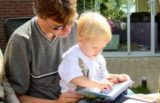 Father reading to his son.