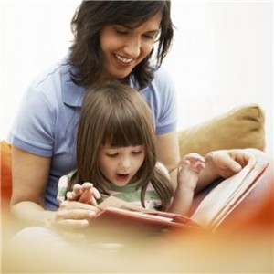 Mommy and a girl reading a book together.