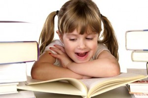 A young girl happy about reading.