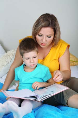Mom teaching little boy to read.