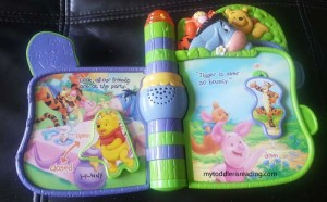 Inner pages of VTech Slide 'N Learn Storybook featuring Winnie the Pooh and Friends.